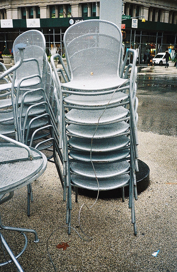 Stacked metal chairs in New York City